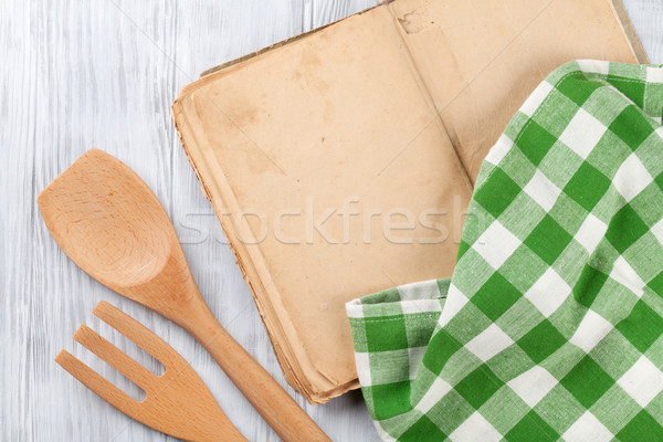 Kitchen table with recipe book and utensils Stock photo © karandaev
