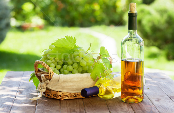 White wine and grapes Stock photo © karandaev