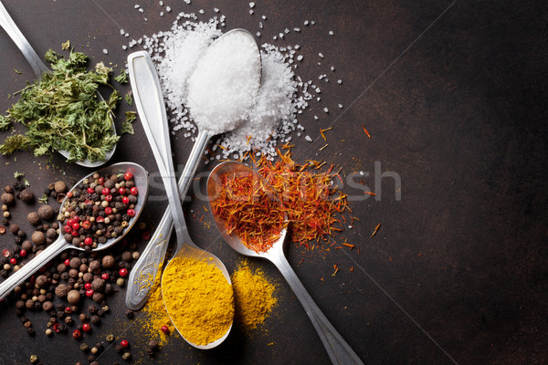 Various spices spoons on stone table Stock photo © karandaev