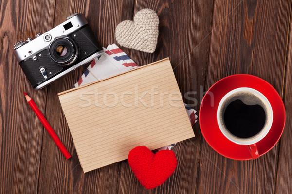 Valentines day hearts, camera, coffee and notepad Stock photo © karandaev