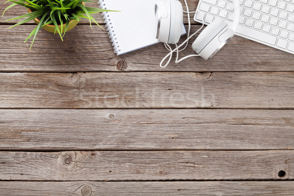 Headphones, notepad and pc on wooden table Stock photo © karandaev