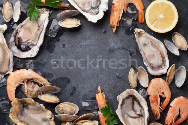 Fresh seafood on stone table Stock photo © karandaev