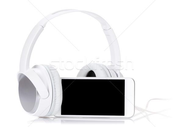 Smartphone Căşti on-line muzică izolat alb Imagine de stoc © karandaev