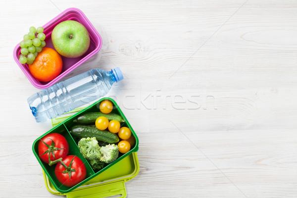 Ebéd doboz zöldség gyümölcsök fa asztal felső Stock fotó © karandaev