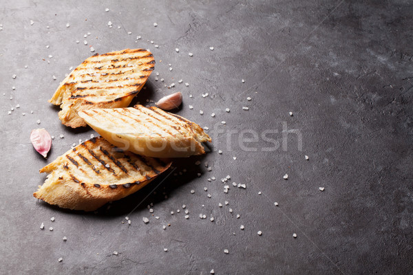 Toast bread with salt and garlic Stock photo © karandaev