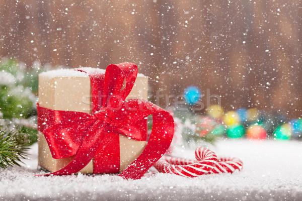 Christmas gift box, candy canes and tree Stock photo © karandaev