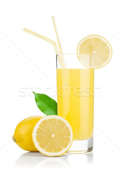 Lemon juice glass and fresh lemons Stock photo © karandaev