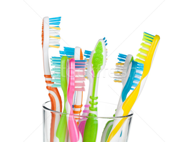 Colorful toothbrushes in glass Stock photo © karandaev