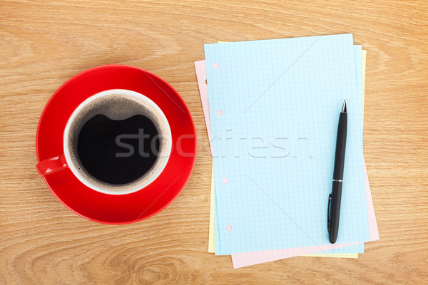 Blank lined papers with coffee cup and pen Stock photo © karandaev