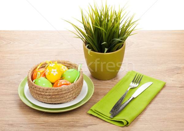 Easter eggs with silverware and potted flower Stock photo © karandaev