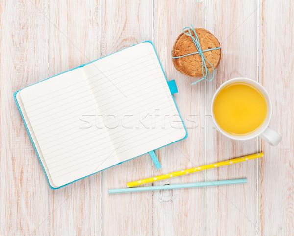 Kubek sok pomarańczowy piernik cookie notatnika biały Zdjęcia stock © karandaev