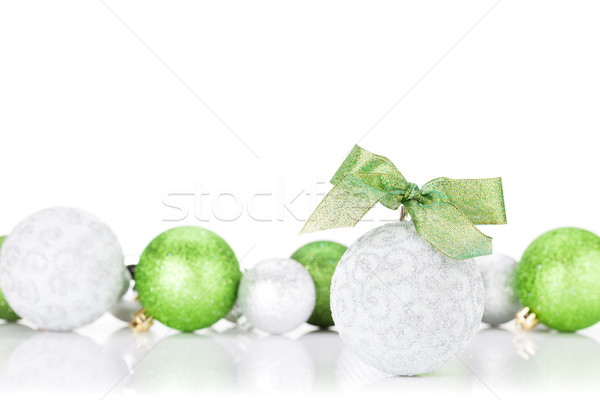 Stock photo: Green and silver christmas baubles