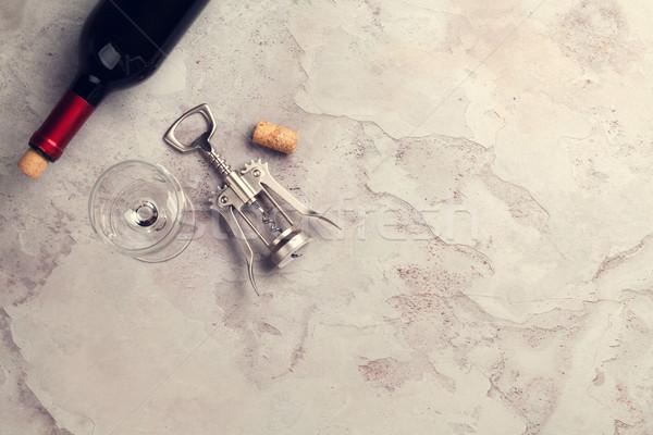 Red wine bottle, glass and corkscrew Stock photo © karandaev