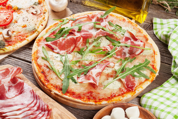 Pizza with prosciutto, tomatoes and mushrooms Stock photo © karandaev