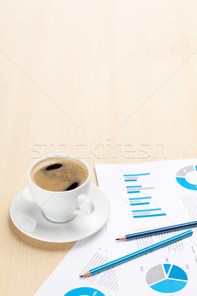Office workplace with coffee cup and charts Stock photo © karandaev