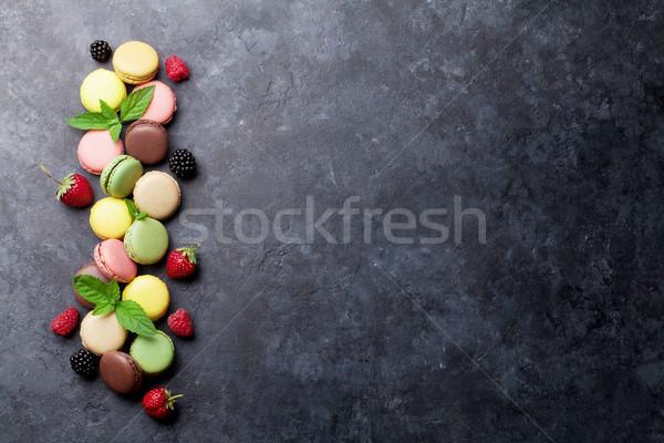 Colorful macaroons and berries Stock photo © karandaev