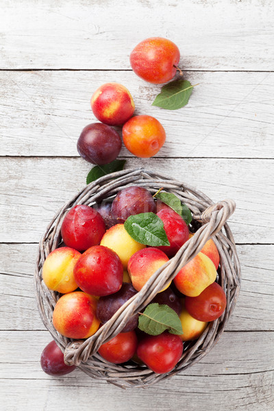 Fresh ripe peaches in basket Stock photo © karandaev