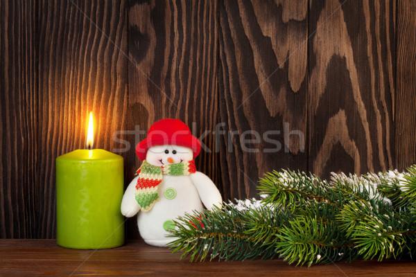Christmas candle, snowman and snow fir tree Stock photo © karandaev