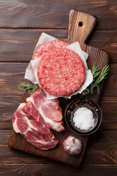 Raw meat and cutlet Stock photo © karandaev
