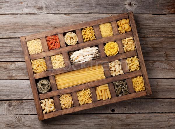 Various pasta in wooden box Stock photo © karandaev