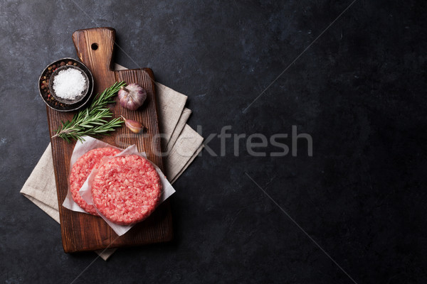 Raw minced beef meat and ingredients for burgers Stock photo © karandaev