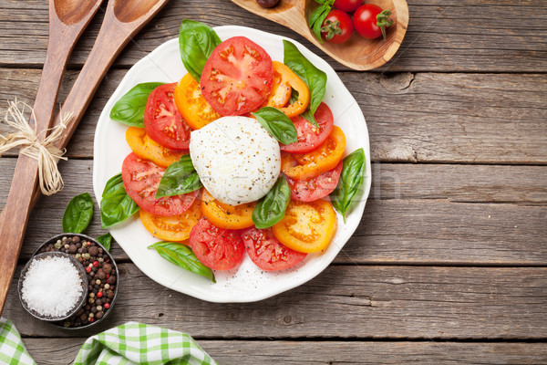 Caprese salad with tomatoes, basil and mozzarella Stock photo © karandaev