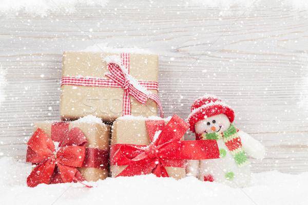 Christmas snowman toy and gift boxes Stock photo © karandaev