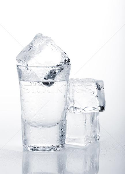 Vodka shot with ice cubes Stock photo © karandaev
