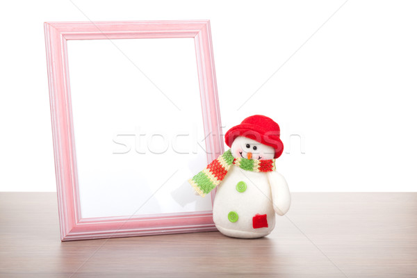 Blank photo frame and christmas snowman on wooden table Stock photo © karandaev