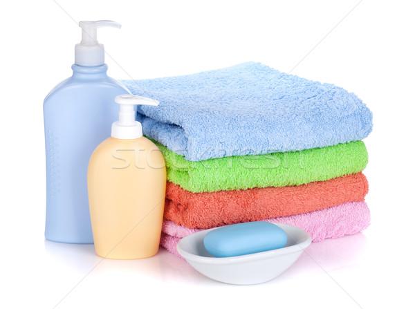 Stockfoto: Cosmetica · flessen · zeep · gekleurd · handdoeken · geïsoleerd