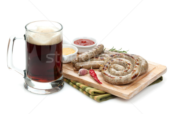 Grilled sausages with ketchup, mustard and mug of beer Stock photo © karandaev