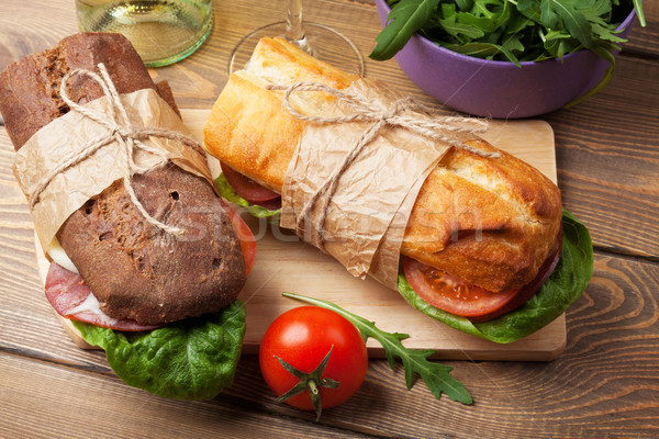 Two sandwiches with salad, ham, cheese Stock photo © karandaev