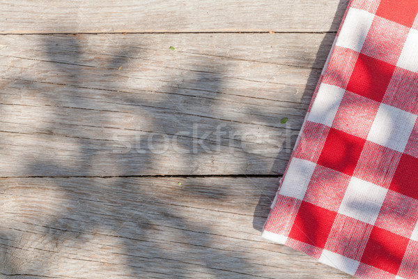 Stock photo: Empty wooden garden table with tablecloth