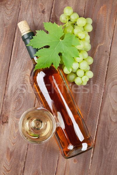 Wine and grape on garden table Stock photo © karandaev