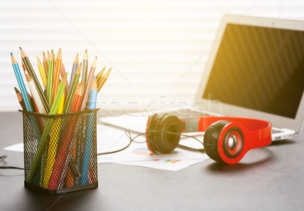 Office workplace with with laptop, headphones and pencils Stock photo © karandaev