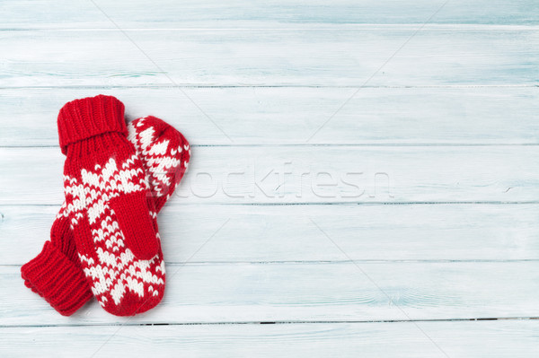 Christmas wooden background with mittens Stock photo © karandaev