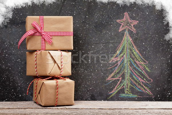 Christmas gift boxes and hand drawn xmas fir tree Stock photo © karandaev