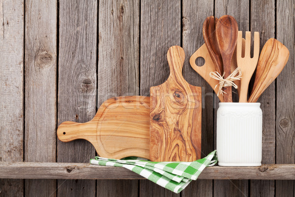 Kitchen cooking utensils on shelf Stock photo © karandaev