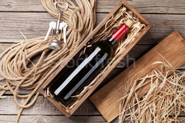 Red wine bottle in box Stock photo © karandaev