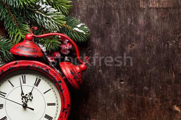 Christmas fir tree and alarm clock Stock photo © karandaev