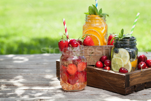 Stock photo: Fresh lemonade jar with summer fruits and berries
