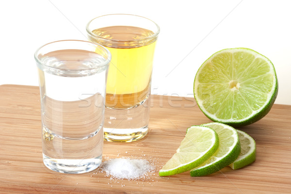 Blanc and Gold Tequila with lime and salt Stock photo © karandaev
