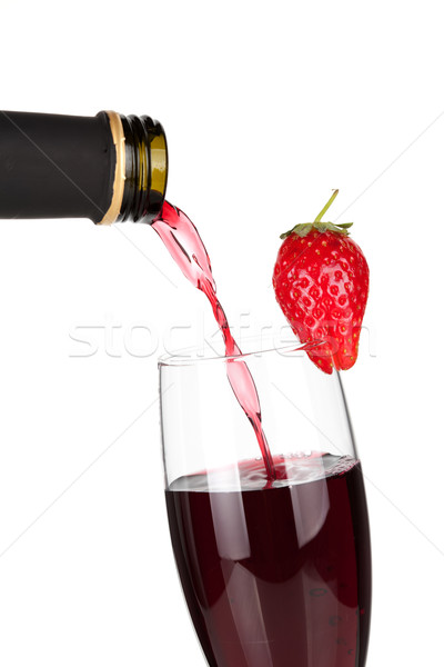 Wine collection - Strawberry champagne pouring down from a bottl Stock photo © karandaev