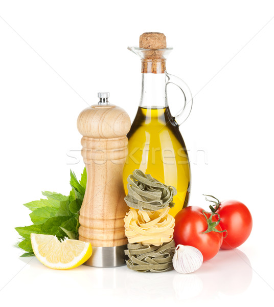 Pasta, ripe tomatoes and condiments Stock photo © karandaev