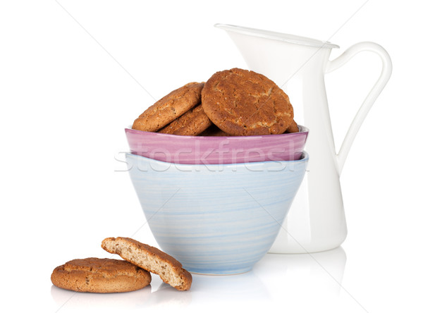 Cookies bowl and milk jug Stock photo © karandaev