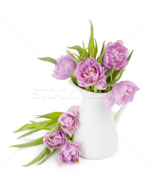 Pink tulips bouquet in pitcher Stock photo © karandaev
