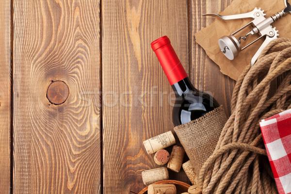 Vörösbor üveg dugóhúzó fa asztal felső kilátás Stock fotó © karandaev