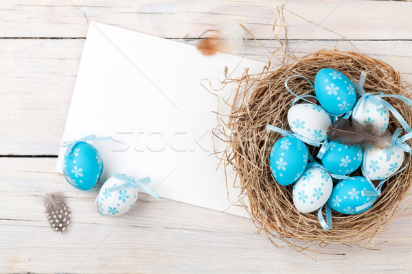 Easter background with blue and white eggs in nest and greeting  Stock photo © karandaev