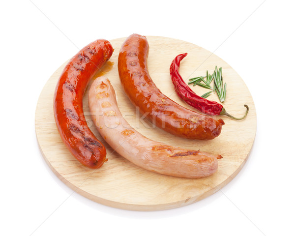 Various grilled sausages with spices Stock photo © karandaev
