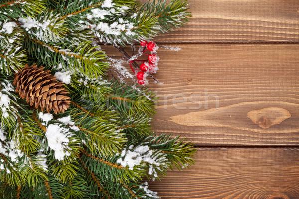 Christmas wooden background with snow fir tree Stock photo © karandaev